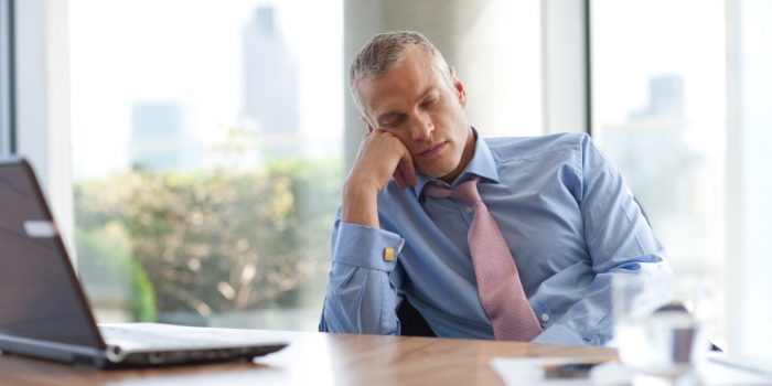 a man falling asleep at the office