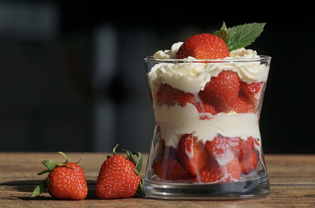 strawberries and cream in a glass
