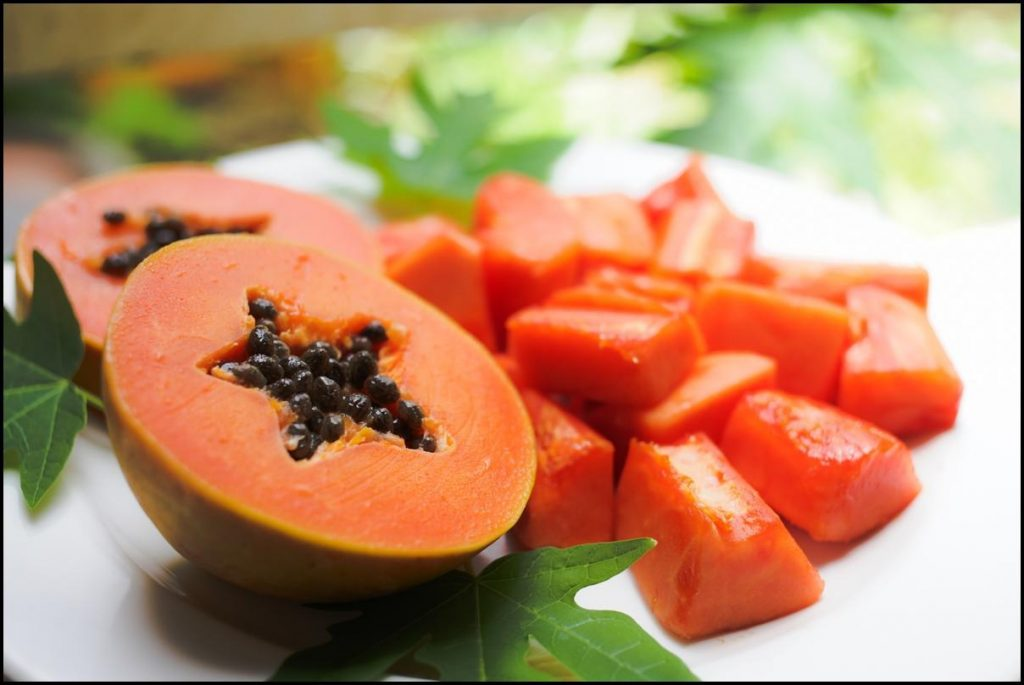 Papaya fruit chopped into pieces and whole